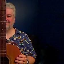 Kevin behind guitar
